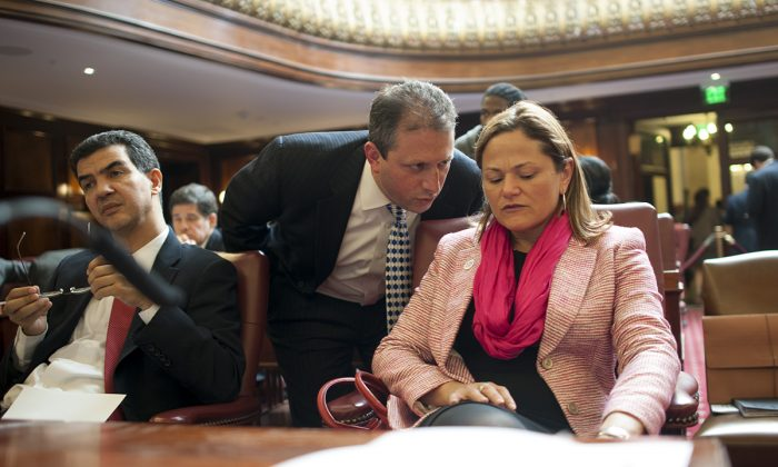 New York City Council Speaker Melissa Mark-Viverito in the City Hall Council Chambers during a session in which an expanded paid sick leave law was passed on Feb. 26, 2014. (William Alatriste/City Council)