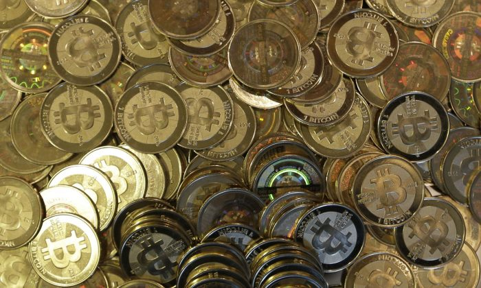 This file photo shows bitcoin tokens in Sandy, Utah. (AP Photo/Rick Bowmer, File)