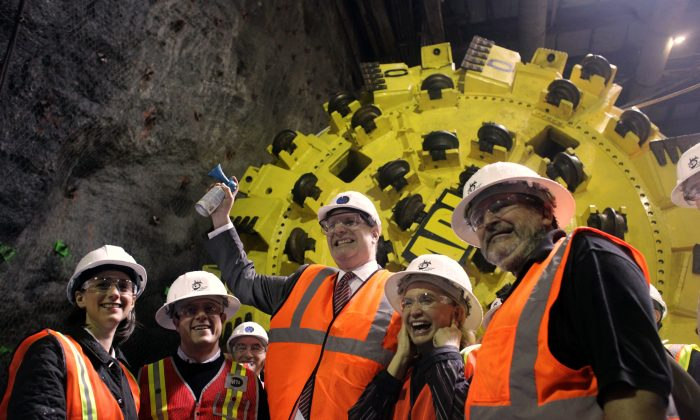 MTA Chairman Jay Walden (C) is joined by city officials and Rep. Carolyn Maloney (2nd R), as he signals the launch of the 2nd Avenue Subway project, on May 14, 2010. (Mary Altaffer/AP)