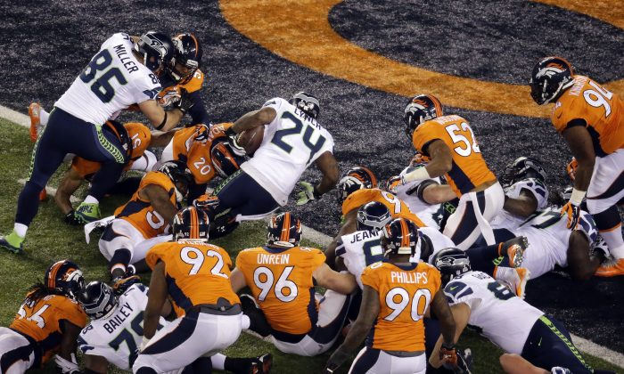 Seattle Seahawks' Marshawn Lynch (24) rushes for a touchdown during the first half of the NFL Super Bowl XLVIII football game against the Denver Broncos  Sunday, Feb. 2, 2014, in East Rutherford, N.J. (AP Photo/Mel Evans)