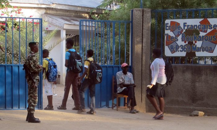 CA Cameroon soldier keeps watch over the entrance to a French school in this November 2013 file photo, because of danger from the Boko Haram sect. (Rennier Kaze/AFP/Getty Images)