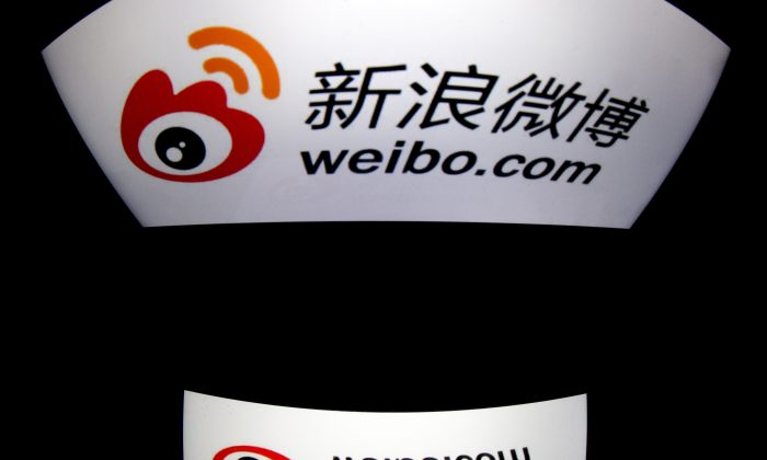 Weibo's logo is displayed on a tablet on Jan. 2, 2014 in Paris. The users of the social media platform in China have declined dramatically following a crackdown on China's Internet that began in March 2012. (Lionel Bonaventure/AFP/Getty Images)