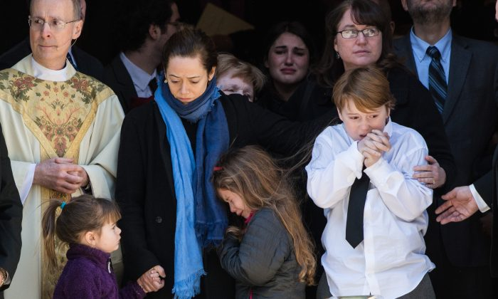 Philip Seymour Hoffman's family, Mimi O'Donnell (C), their children (L-R), Willa Hoffman, Tallulah Hoffman and Cooper Hoffman, at his funeral at St. Ignatius of Loyola in New York, Feb. 7. (Dave Kotinsky/Getty Images)