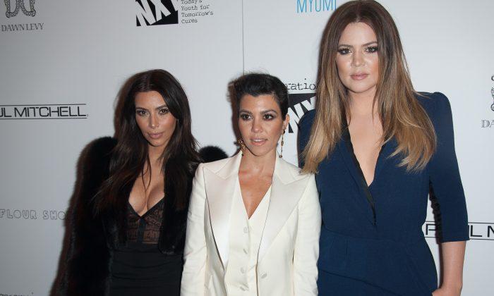 Kim Kardashian, Kourtney Kardashian, and Khloe Kardashian attend Generation NXT Charity Benefit at 1OAK on February 16, 2014 in New York City. (Dave Kotinsky/Getty Images)