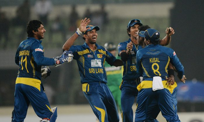 Sri Lankan cricketers react after winning the first One-Day International (ODI) cricket match between Bangladesh and Sri Lanka at the Sher-e-Bangla National Cricket Stadium in Dhaka on February 17, 2014. (AFP/Getty Images)