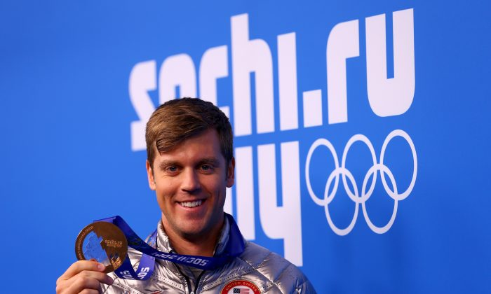 Bronze medalist Alex Deibold of the United States celebrates during the medal ceremony for the Men's Snowboard Cross on day 11 of the Sochi 2014 Winter Olympics at Medals Plaza on February 18, 2014 in Sochi, Russia. (Paul Gilham/Getty Images)