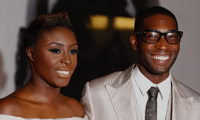 British singer-songwriter Laura Mvula (L) and British rapper Tinie Tempah (R) pose on the red carpet arriving at the BRIT Awards 2014 in London on February 19, 2014. (AFP/Getty Images)