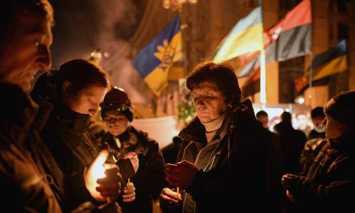 Prayers are held for victims who have died during anti-government protesters, clashed with police in Independence square, despite a truce agreed between the Ukrainian president and opposition leaders in Kyiv, Ukraine, on Feb. 20, 2014.  (Jeff J. Mitchell/Getty Images)