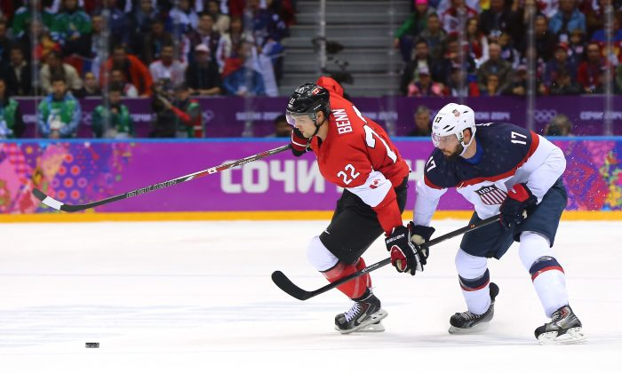 Jamie Benn #22 of Canada handles the puck against Ryan Kesler #17 of the United States in the first period during the Men's Ice Hockey Semifinal Playoff on Day 14 of the 2014 Sochi Winter Olympics at Bolshoy Ice Dome on February 21, 2014 in Sochi, Russia. (Martin Rose/Getty Images)