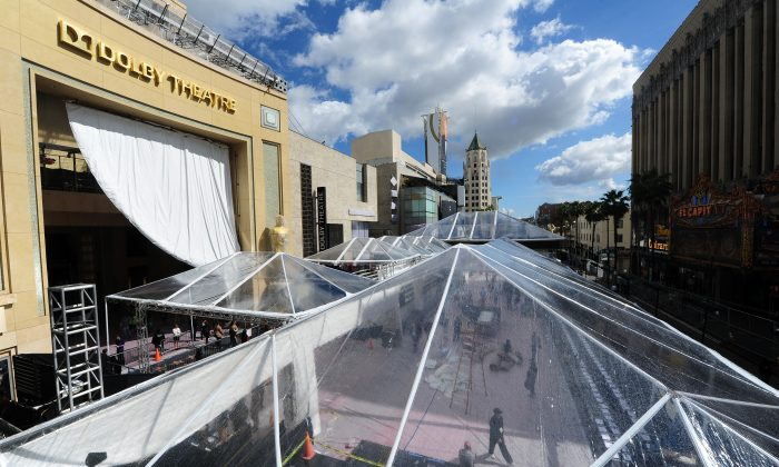 A giant tarp provides the cover for expected rain as preparations continue on a covered-up Red Carpet along Hollywood Boulevard in front of the Dolby Theater on February 27, 2014 in Hollywood, California, for the 86th Academy Awards which take place on Mar. 2. (FREDERIC J. BROWN/AFP/Getty Images)