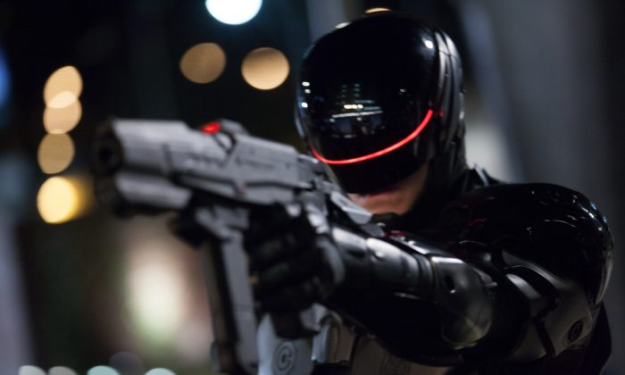 """This image released by Columbia Pictures shows Joel Kinnaman in a scene from """"RoboCop."""" (AP Photo/Columbia Pictures - Sony, Kerry Hayes)"""