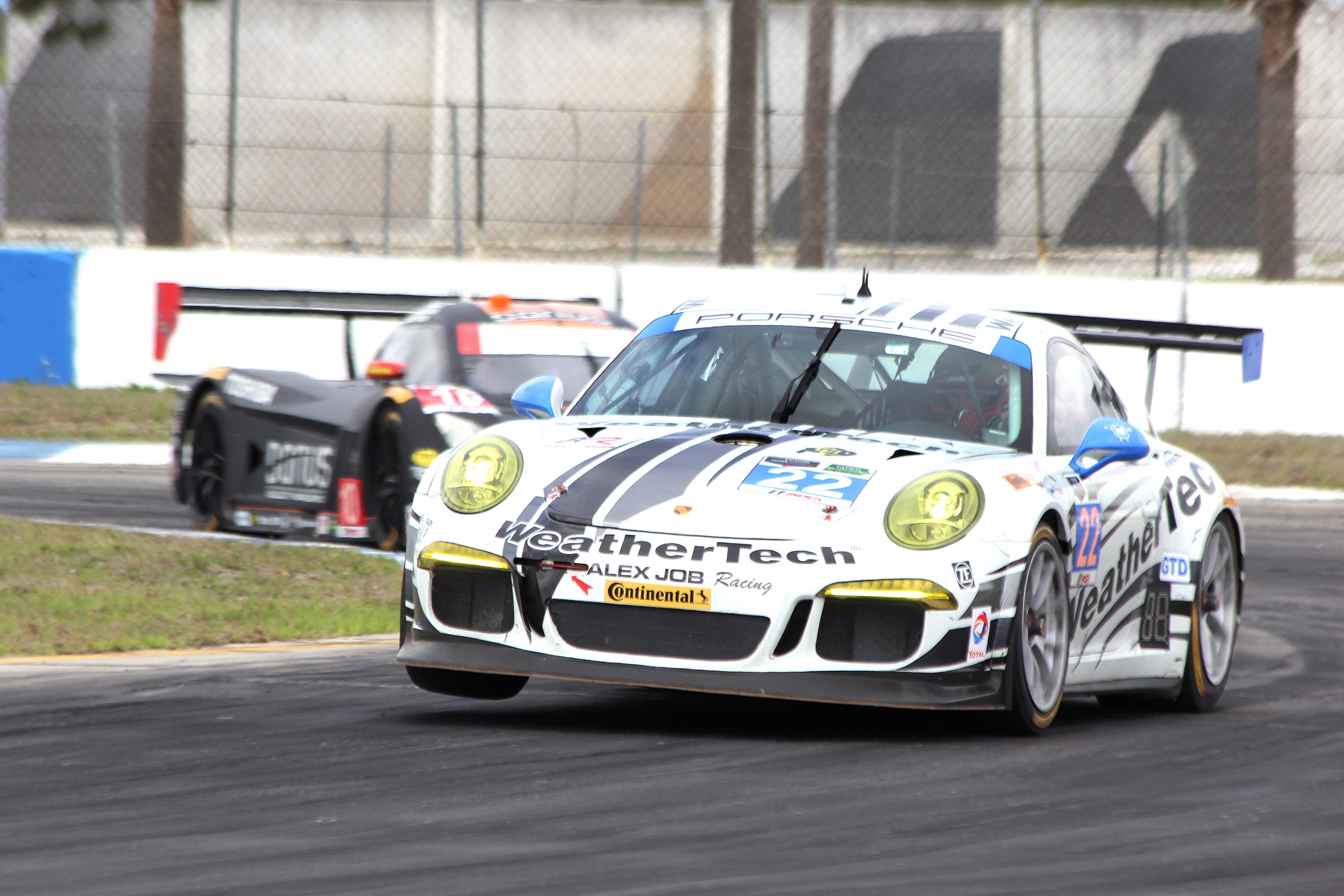 The #23 Alex Job Porsche tries to wheelie around Turn Ten. (Chris Jasurek/Epoch Times)