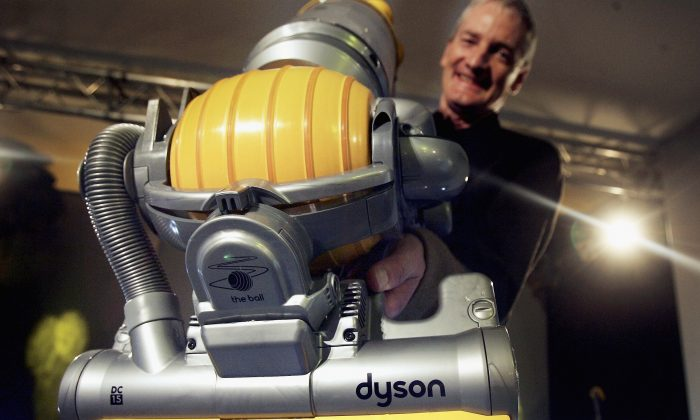 Inventor James Dyson demonstrates his latest hoovering invention on March 14, 2005 in London. The vaccum cleaner replaces the traditional four wheels with one ball to guide it across the floor giving it increased maneouverability. (Bruno Vincent/Getty Images)