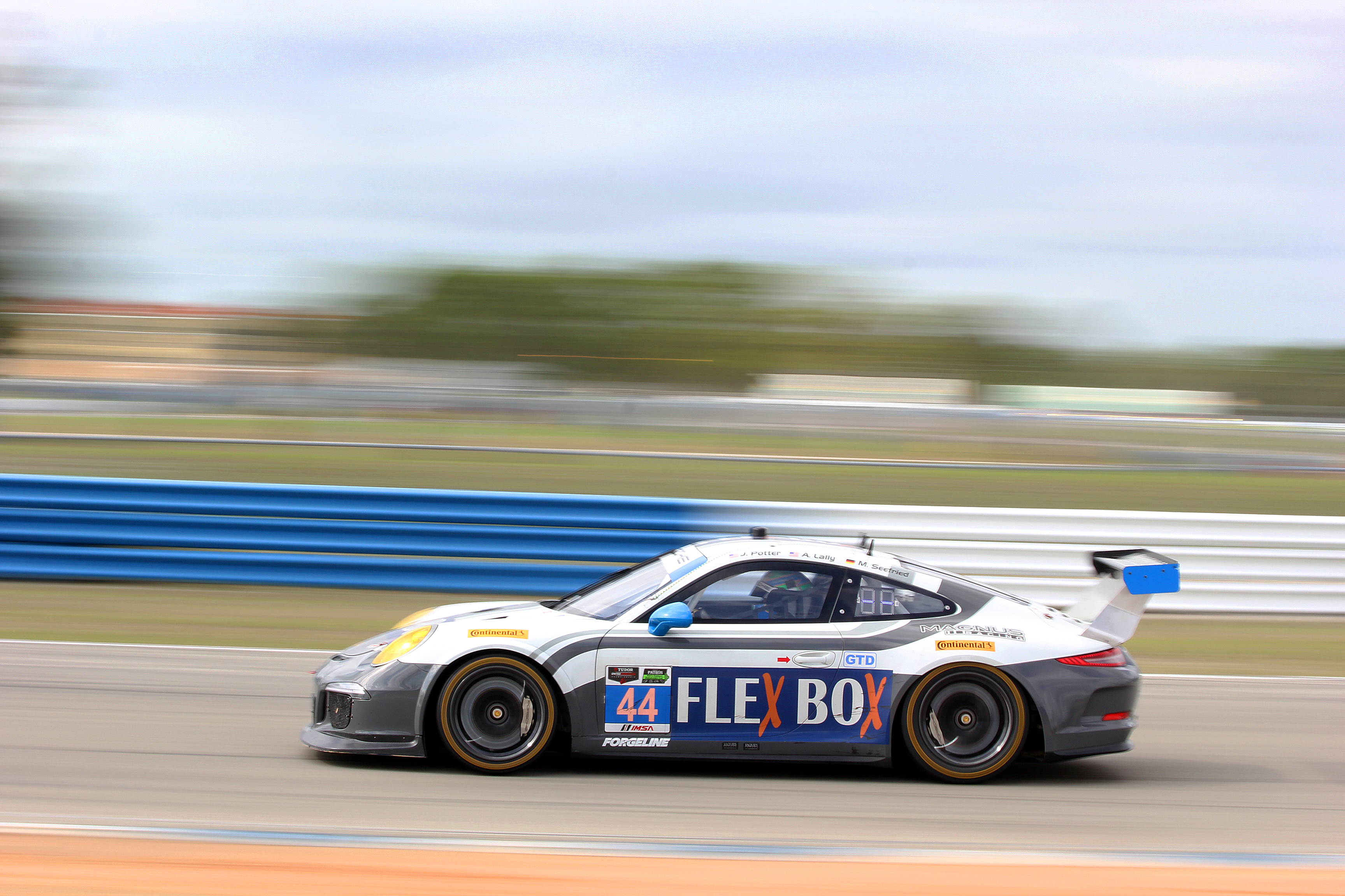 The #44 GTD Magnus Porsche streaks towards Turn 11 Friday morning. (Chris Jasurek/Epoch Times)