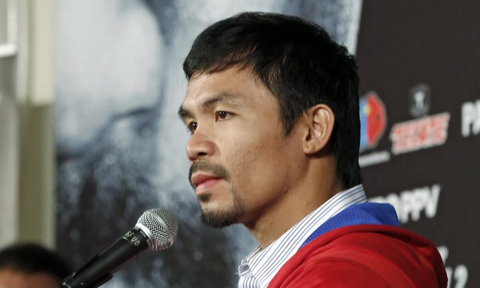 Manny Pacquiao, of the Philippines, speaks at a news conference in Beverly Hills, Calif., Tuesday, Feb. 4, 2014. (AP Photo/Reed Saxon)