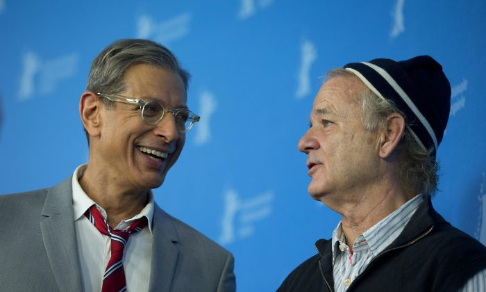 Actors Jeff Goldblum and Bill Murray speak to each other at the photo call for the film The Grand Budapest Hotel during the International Film Festival Berlinale, in Berlin, Thursday, Feb. 6, 2014.  (AP Photo/Axel Schmidt)