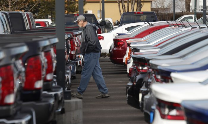 In this Sunday, Jan. 20, 2013, file photo, a buyer moves between rows of Ram pickup trucks and Dart sedans at a Dodge dealership in Littleton, Colo. Chrysler says its U.S. sales rose 8 percent in January 2014, as it posted strong growth despite the frigid weather that gripped much of the nation. (AP Photo/David Zalubowski, File)