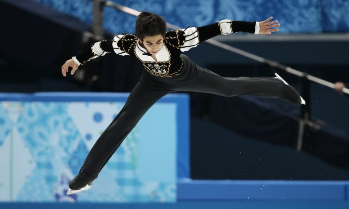 Michael Christian Martinez of the Philippines competes in the men's short program figure skating competition at the Iceberg Skating Palace during the 2014 Winter Olympics, Thursday, Feb. 13, 2014, in Sochi, Russia. (AP Photo/Ivan Sekretarev)