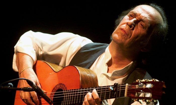 Spanish guitar player Paco de Lucia during his performance on the Stravinski hall stage of the 35th Montreux Jazz Festival in Montreux, Switzerland, Thursday, July 12, 2001. (AP PHOTO/KEYSTONE/Laurent Gillieron)