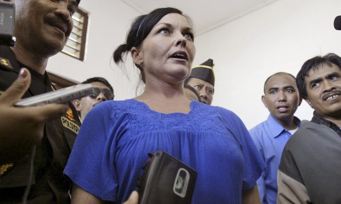 Schapelle Corby, center, an Australian serving a jail term for drug smuggling, reacts to reporter's question in a 2008 file photo. Corby was recently released from jail in Bali, Indonesia. (AP Photo/Firdia Lisnawati)