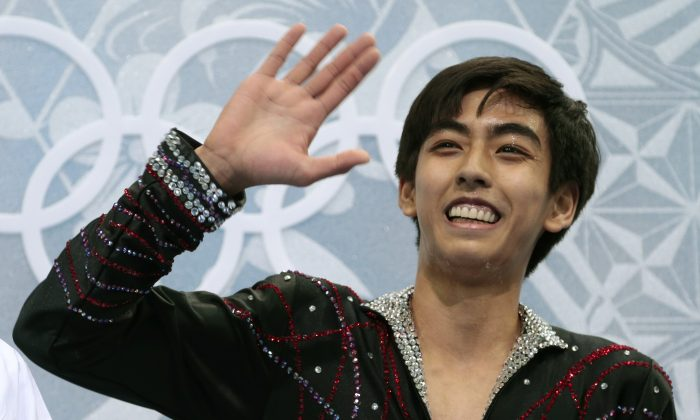 Michael Christian Martinez of the Philippines waves to spectators as he waits for his results after the men's free skate figure skating final at the Iceberg Skating Palace at the 2014 Winter Olympics, Friday, Feb. 14, 2014, in Sochi, Russia. (AP Photo/Ivan Sekretarev)