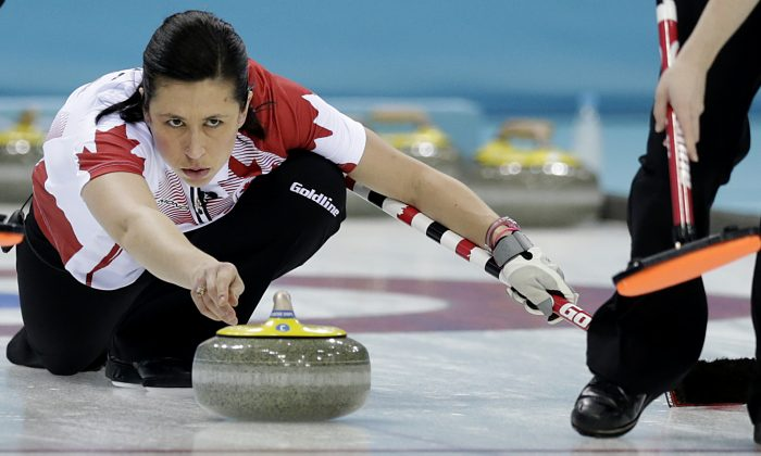 Canada's Jill Officer releases the rock during the women's curling semifinal game against Britain at the 2014 Winter Olympics, Wednesday, Feb. 19, 2014, in Sochi, Russia. (AP Photo/Wong Maye-E)