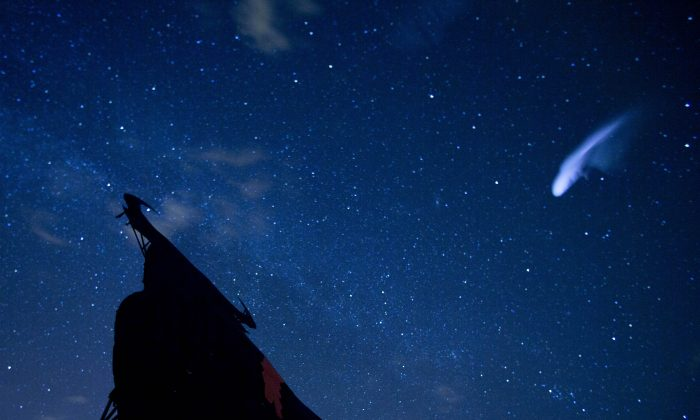 A streak appears in the sky during the annual Perseid meteor shower above a roadside silhouette of a Spanish fighting bull in Villarejo de Salvanes, central Spain, in the early hours of Aug. 12, 2013. (AP Photo/Paul White)