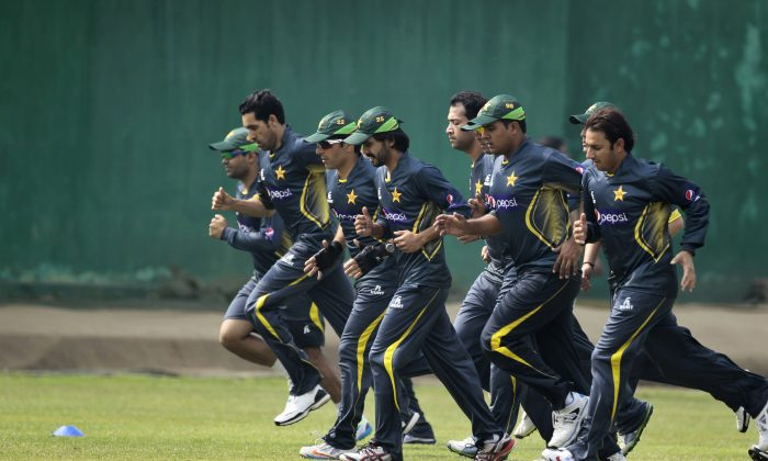 Pakistani cricket team members warm up during a practice session ahead of the Asia Cup tournament in Dhaka, Bangladesh, Sunday, Feb. 23, 2014. Pakistan plays Sri Lanka in the opening match of the five nation one day cricket event that begins Tuesday. (AP Photo/A.M. Ahad)