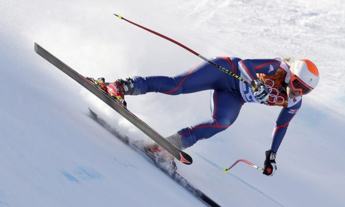 Britain's Chemmy Alcott makes a turn during the women's downhill at the Sochi 2014 Winter Olympics, Wednesday, Feb. 12, 2014, in Krasnaya Polyana, Russia.(AP Photo/Charles Krupa)