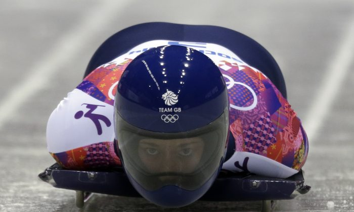Lizzy Yarnold during the women's skeleton competition at the 2014 Winter Olympics, Friday, Feb. 14, 2014, in Krasnaya Polyana, Russia. (AP Photo/Natacha Pisarenko)