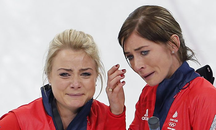 Britain's skip Eve Muirhead, right, and Anna Sloan, left, cry as they celebrate beating Switzerland in the women's curling bronze medal game at the 2014 Winter Olympics, Thursday, Feb. 20, 2014, in Sochi, Russia. (AP Photo/Wong Maye-E)