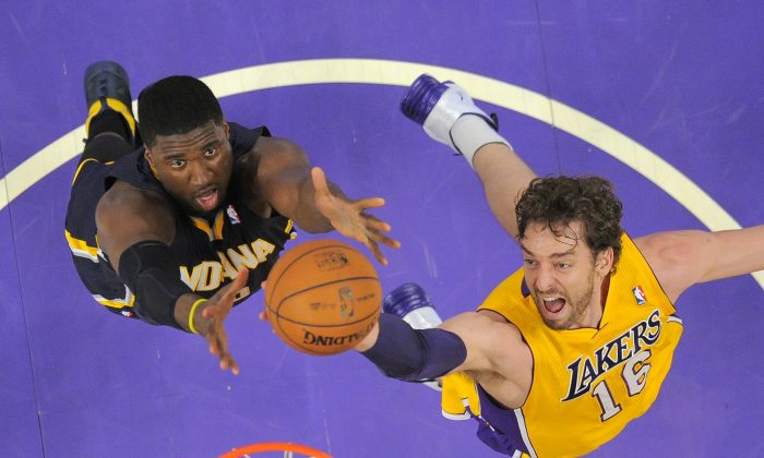 Pau Gasol of the Los Angeles Lakers battles for a rebound with Roy Hibbert of the Indiana Pacers in a file photo. (AP Photo/Mark J. Terrill)