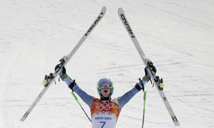 Ted Ligety celebrates after winning the gold medal in the men's giant slalom at the Sochi 2014 Winter Olympics. (AP Photo/Charlie Riedel)