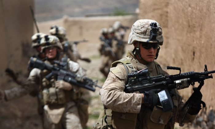 Marine machine gunner LCpl. Daniel Wescovich (R), patrols with his squad on April 2, 2009 in Now Zad in Helmand province, Afghanistan. (John Moore/Getty Images)
