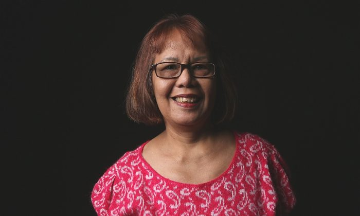 Filipina immigrant Rebecca Ocampo, 64, stands for a portrait before being naturalized as an American Citizen on March 22, 2013 in New York City. (John Moore/Getty Images)
