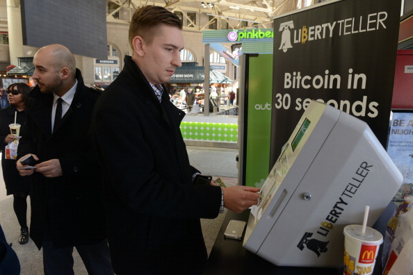 Derek Gilroy purchases some Bitcoin from a newly installed Bitcoin ATM at South Station on Feb. 20 in Boston, Massachusetts. The ATM was placed by Liberty Teller to help inform people about the digital currency, which can be bought and sold anonymously, and can be used at a number of online retailers in place of cash or credit cards. (Darren McCollester/Getty Images)