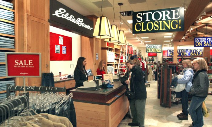 Shoppers pay for their purchases at a closing Eddie Bauer store January 9, 2004 in Bloomingdale, Illinois. Store-closing liquidation sales started today at 29 Eddie Bauer stores across the country. (Tim Boyle/Getty Images)
