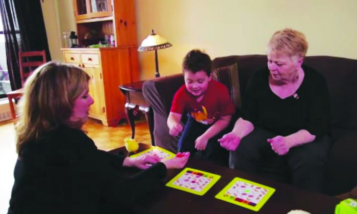 IPF patient Larkell Bradley plays a game with her daughter and 6-year-old grandson. (Courtesy Canadian Pulmonary Fibrosis Foundation)
