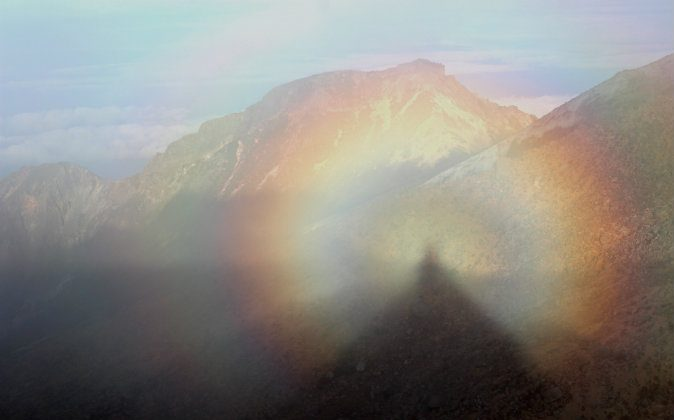 Brocken spectre on Mount Ontake, in Nagano Prefecture, Japan. Brocken spectres are shadows surrounded by rainbow light that appear hauntingly in the mountains. Learn more about them below. (Wikimedia Commons)