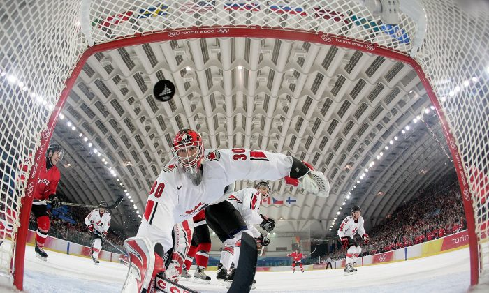 Canadian goalie Martin Brodeur sees a Swiss shot get past him. Switzerland beat Canada at the 2006 Olympics in Turin, Italy. (Elsa/Getty Images)