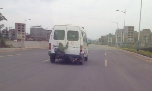 Chinese Man Escapes on Back of Ambulance