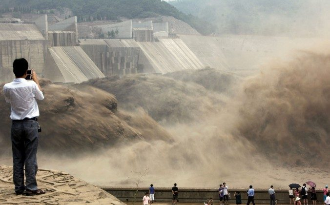 Giant gushes of water are released from the Xiaolangdi Dam to clear up the sediment-laden Yellow River and to prevent localized flooding, in Jiyuan, in central China's Henan Province on July 6, 2012. (STR/AFP/GettyImages)