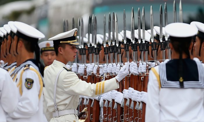 "Chinese naval soldiers line up in Beijing, China on Sept. 16, 2013. Capt. James Fannell, of the U.S. Pacific Fleet, says China is training for a ""short, sharp war"" with Japan. (Feng Li/Getty Images)"