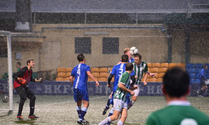 Albion were under pressure when KCC Dragons centred the ball from a corner during their Yau Yee League match at HKFC Ground, Sports Rd, on late Sunday afternoon Feb 9, 2014. KCC won the scrappy game in cold and wet conditions that turned out to be a 3-2 thriller. (Bill Cox/Epoch Times)