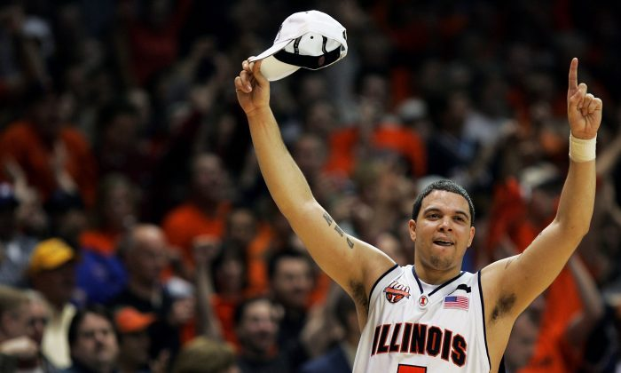 Deron Williams #5 of the Illinois Fighting Illini celebrates after victory over the Arizona Wildcats in the Chicago Regional Final in the NCAA Division I Men's Basketball Championship at the Allstate Arena on March 26, 2005 in Chicago, Illinois. Ilinois defeated Arizona 90-89 in overtime. (Photo by Jonathan Daniel/Getty Images)
