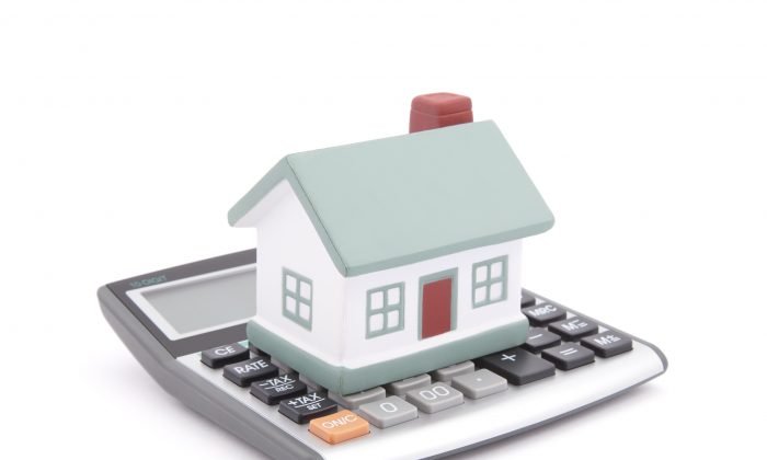 Canadians have been easing up on mortgage financing as evidenced in 2013 when residential mortgage debt grew at the slowest pace in 13 years. (Fotolia)