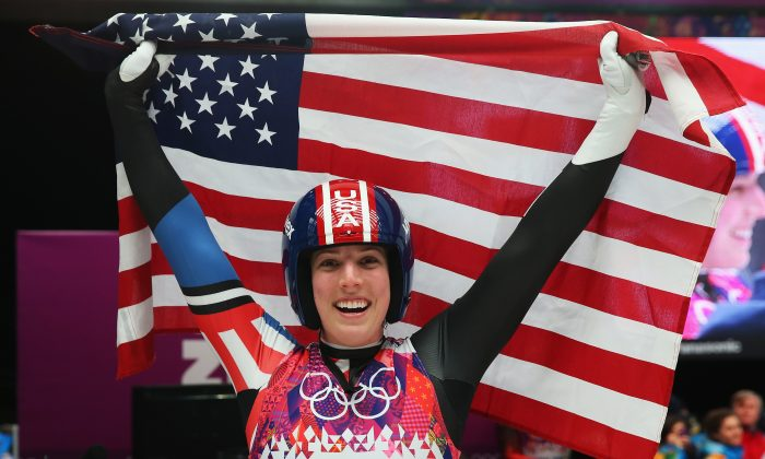 Erin Hamlin of the United States celebrates during the Women's Luge Singles on Day 4 of the Sochi 2014 Winter Olympics at Sliding Center Sanki on February 11, 2014 in Sochi, Russia. (Alexander Hassenstein/Getty Images)