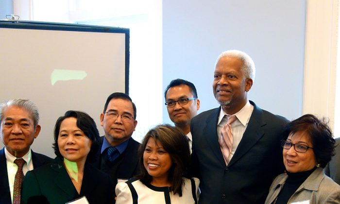 Rep. Hank Johnson (D-Ga.), (C) with attendees at the Asian-American Legislative Breakfast at the Freight Depot in Atlanta, Feb. 10. (Mary Silver/Epoch Times)