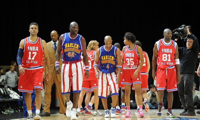 Actor Rick Fox, Nate 'Big Easy' Lofton and Herbert 'Flight Time' Lang of the Harlem Globetrotters, basketball player Angel McCoughtry, and NFL player Terrell Owens walk on the court during the NBA All-Star celebrity game presented by Final Fantasy XIII held at the Dallas Convention Center on February 12, 2010 in Dallas, Texas. (Jason Merritt/Getty Images)