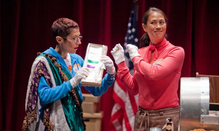 (L–R) Rachel Grossman and Elaine Yuko Qualter show artifacts from the time capsule. (C. Stanley Photography)